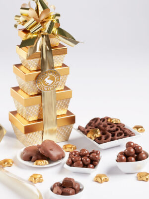 5 gold box tower filled with gourmet milk chocolates with gold bow. chocolate ballotin tower.