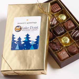 1/2 lb box of chocolate wrapped in gold with a custom logo sticker