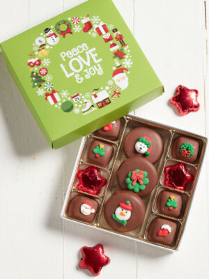 Green Holiday Binge box filled with an 11pc chocolate assortment of caramels, cookies and foiled stars.