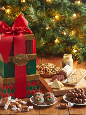Green and red holiday feast tower with assorted chocolates