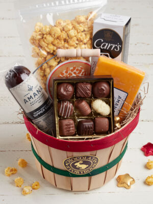 Gift basket filled with sausage, cheese, caramel popcorn, crackers and chocolates