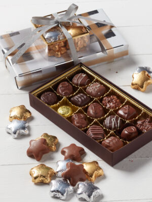1/2 lb. assorted chocolate set wrapped in festive paper and topped with gold and silver foil chocolate stars.