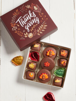 Box of chocolate caramels and cookies thanksgiving themed