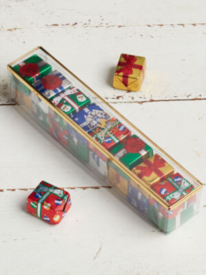 Assortment of foil wrapped chocolate Christmas presents